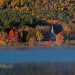 Small white church surrounded by fall foliage in Easton NH