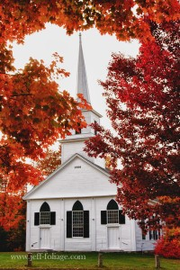New Salem white church with fall foliage framing the steeple