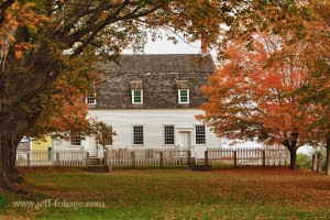 Autumn fall foliage surrounds the property of the Shaker Museum