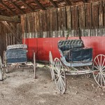 Several old buggies await their ponies for a ride through the fall foliage