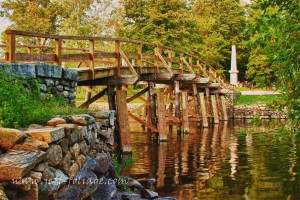 New England fall foliage over the Old North Bridge in Concord