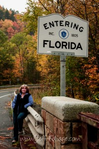 Lisa standing at a entering Florida sign. The sign is in the Berkshires of Massachusetts
