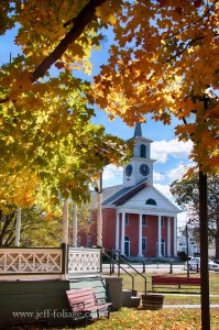 Fall foliage of yellow and orange with a townsend MA bandstand and church
