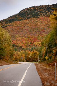 fall foliage lines the road,traveling south on route 16 below Pinkham notch in New Hampshire