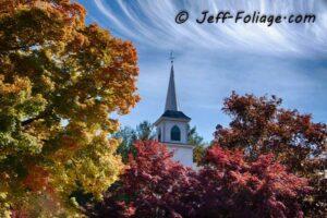Red, green, orange and yellow surround this Massachusetts church.