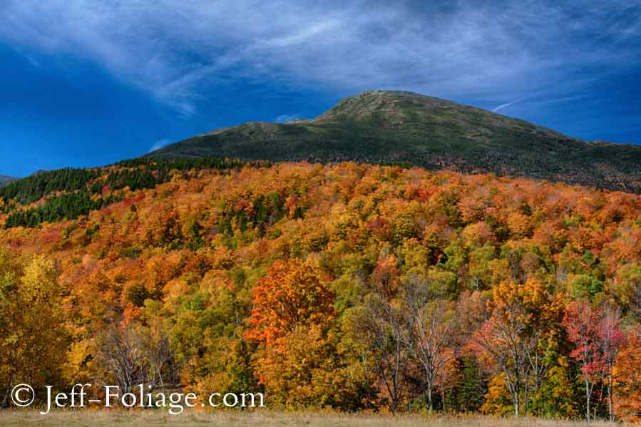 a tapestry of fall colors across the foot of Mount washington