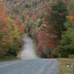 New England fall foliage color covering the hills above Granby Road