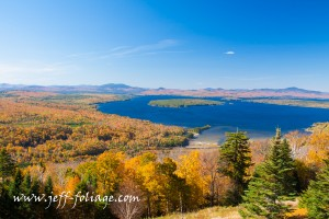 New England fall foliage stretching as far as the eye can see in Rangeley Lake Maine