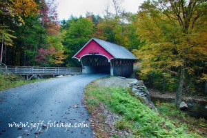 "Flume gorge covered bridge in Franconia Notch. A red covered bridge that looks great early in the morning.. ""Autumn foliage New England"", ""Autumn foliage"", ""Fall Foliage"", ""fine art photography for sale"", ""fine art photography prints"", ""Flume Gorge covered bridge"", ""Franconia Notch"", ""Image by Jeff Folger"", ""images of nature photography"", ""nature photography"", ""New England Autumn"", ""New England color"", ""New England fall foliage"", ""new england landscape photography"", ""New England leaves"", ""new england photography"", ""New England"", ""New Hampshire fall foliage"", ""photos stock images"", ""Scenic New England photography"", ""tapestry of color"", Autumn, Fall, Foliage, Landscape, leaves, Nature, New England covered bridge"", New Hampshire covered bridge"", Travel, trees, vistaphotography"