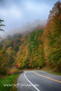 late Sept fall colors rising above the road