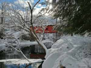 A blanket of white covers the Slaughterhouse covered bridge