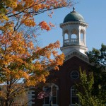 Woodstock court house in the autumn framed by Vermont fall colors